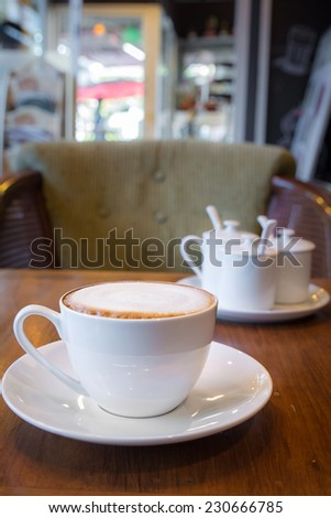 Latte coffee cup in the coffee shop  - stock photo