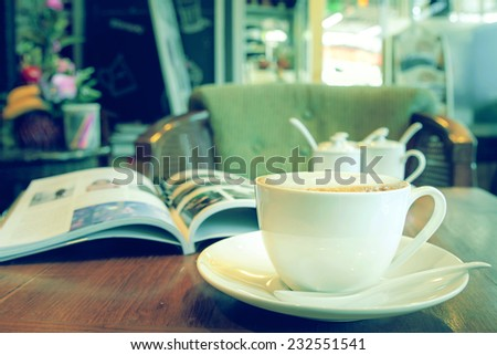 Latte coffee cup in the coffee shop, vintage green tone  - stock photo