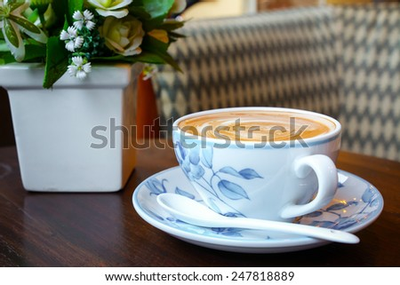 Latte coffee cup on the table  - stock photo