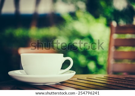 Latte coffee cup on wooden table - vintage effect style pictures