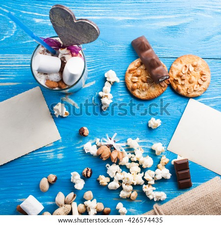 Latte coffee in cup with spices on wood desk. Process serving - stock photo