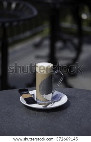 Latte coffee in stylish cup - stock photo