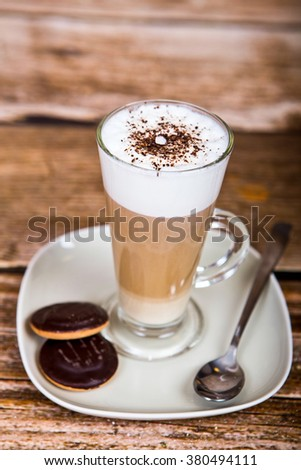 Latte Coffee in tall latte glasses with table settings - stock photo