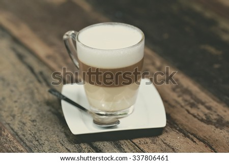 latte coffee or caffe latte on wooden table