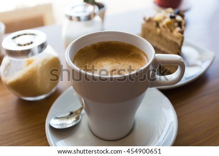 Latte coffee with coffee cake in coffee shop,view from the top. - stock photo