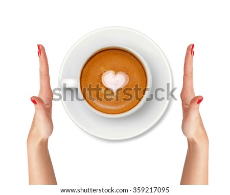 Latte coffee with heart symbol and woman hands isolated on white background - stock photo