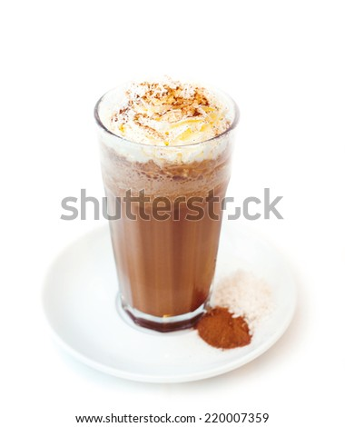 Latte macchiato coffee prepared by italian way with traditional coffee. Presented with whipped-cream on the top and coffee. Presented on a white plate