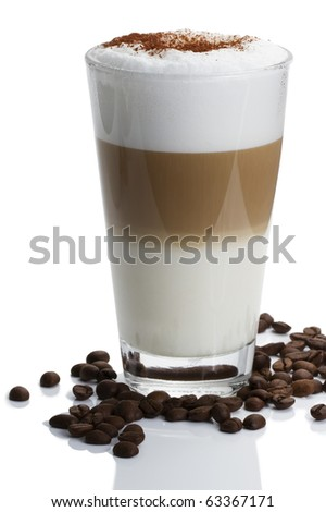 latte macchiato with cocoa powder and coffee beans on white background - stock photo
