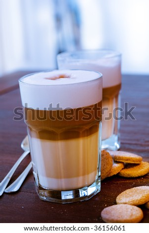 Latte Macchiato with some cookies - stock photo