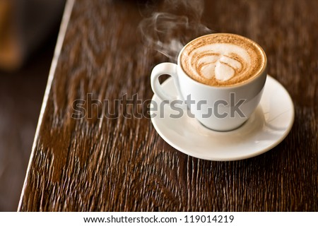 latte on a wood table - stock photo