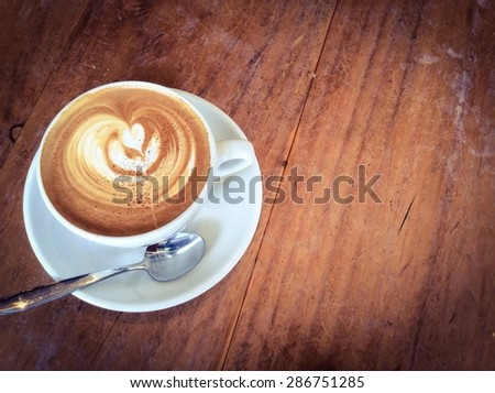Latte or cappuccino coffee  in vintage  retro filter effect - stock photo