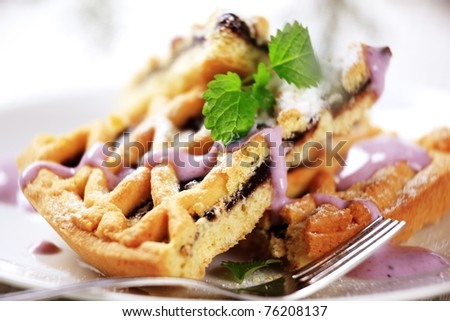 Lattice topped cake with fruit filling - stock photo