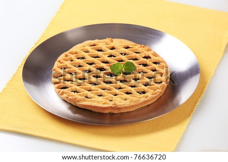 Lattice topped tart with fruit filling  - stock photo