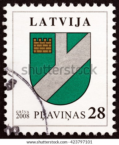 """LATVIA - CIRCA 2008: A stamp printed in Latvia from the """"Coat of Arms """" issue shows Coat of Arms of Plavinas, circa 2008. - stock photo"""