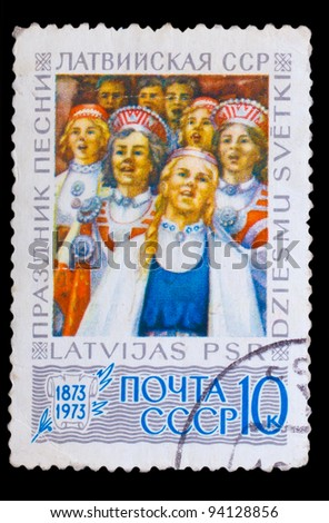 LATVIA - CIRCA 1978: A stamp printed in LATVIA, holiday songs, and Latvian SSR, Girls in traditional dress, circa 1978