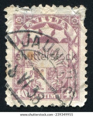 LATVIA - CIRCA 1923: stamp printed by Latvia, shows Arms and Stars for Vidzeme, Kurzeme and Latgale, circa 1923 - stock photo