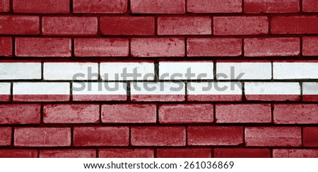 Latvia flag painted on old brick wall texture background - stock photo
