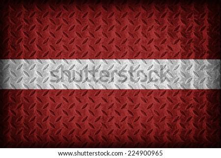 Latvia flag pattern on the diamond metal plate texture ,vintage style - stock photo
