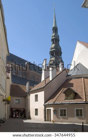 Latvia, Riga. A medieval court yard against St. Peter's church