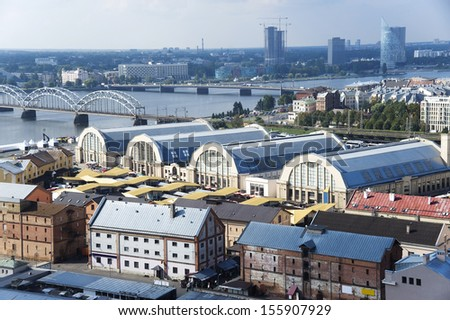 Latvia, Riga. View of pavilions of the central market , warehouses and bridges. - stock photo