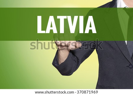 Latvia word Business man touch on vintage yellow green tab virtual screen - stock photo