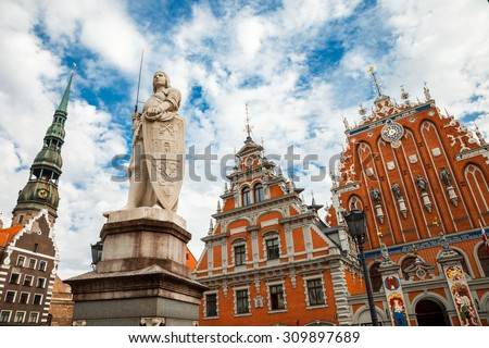 Latvian  attraction - house of the Blackheads, sculpture of Saint Roland and Saint Peters Church in old city Riga, Latvia - stock photo