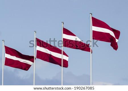 Latvian flags - stock photo