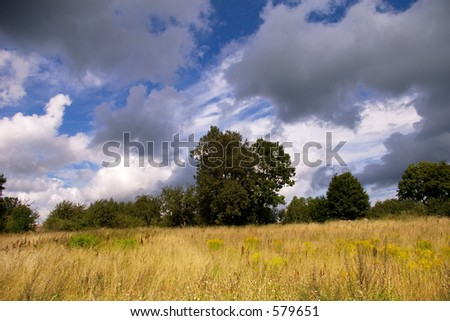 Latvian landscape, clouds over a meadow