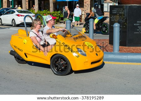 LAUDERDALE BY THE SEA, FLORIDA - JANUARY 16: Couple driving in a small rental vehicle in Lauderdale By The Sea, FL on January 16, 2016 - stock photo