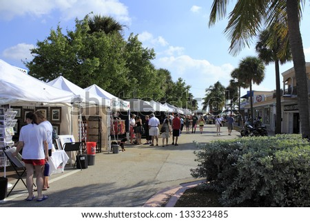 LAUDERDALE-BY-THE-SEA, FLORIDA - OCTOBER 28: People shopping at the annual craft festival where local crafters display at outdoor galleries on October 28, 2012 in Lauderdale-by-the-Sea, Florida. - stock photo