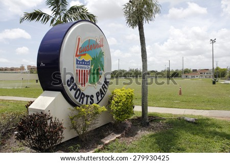 LAUDERHILL, FL, USA - JUNE 19, 2014: Large and colorful entrance sign for the Lauderhill Sports Park in front of a soccer field. The plastic sign also mentions that Lauderhill is an All-American City - stock photo