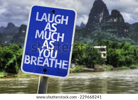 Laugh As Much As You Breathe sign with a exotic background - stock photo