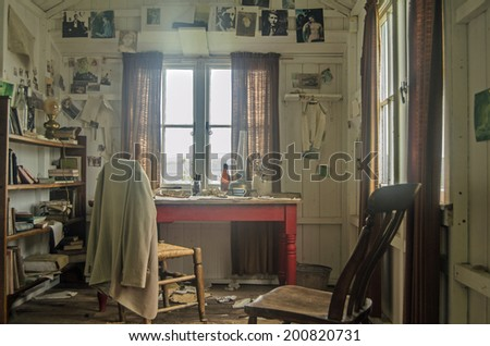 LAUGHARNE, UK - May 5, 2014: Inside the wooden shed occupied by the great Welsh writer Dylan Thomas while writing his plays and poems overlooking the River Taf estuary in Laugharne, Carmarthenshire. - stock photo