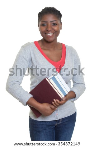Laughing african american student with books