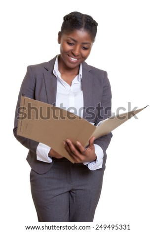 Laughing african business woman reading file - stock photo
