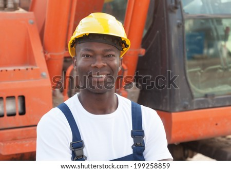 Laughing african construction worker with red excavator  - stock photo