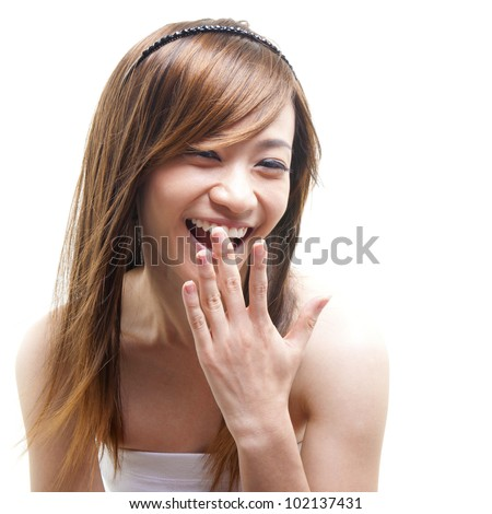 Laughing Asian woman covering her mouth on white background - stock photo