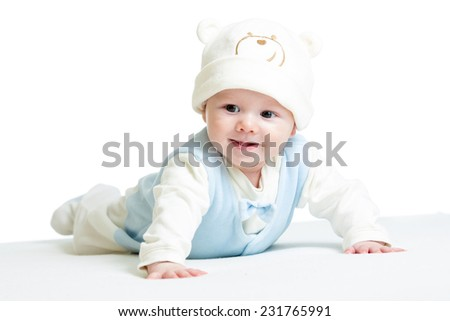 laughing baby boy weared funny hat lying on belly - stock photo