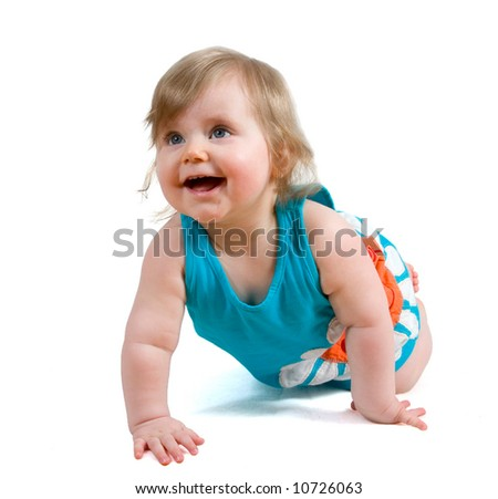 Laughing baby girl in blue summer dress crawling isolated on white background