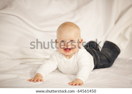 laughing baby girl lying on a blanket
