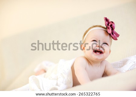 Laughing baby girl with hair rim