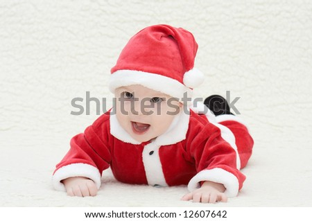 laughing baby in santa's suit - stock photo