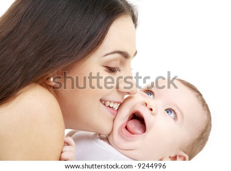 laughing baby playing with mother (focus on mama) - stock photo