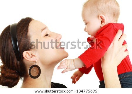laughing baby playing with mother isolated on white - stock photo