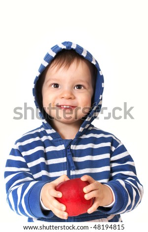 laughing baby with red apple - stock photo