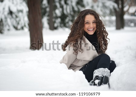 Laughing beautiful girl portrait in winter time with snow. - stock photo
