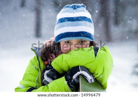 Laughing beautiful girl snowboarder, snowfall (series Sport, Extreme, Mountains, Horses and Teenagers) - stock photo