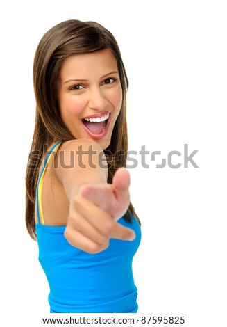 laughing beautiful woman points towards camera isolated on white - stock photo