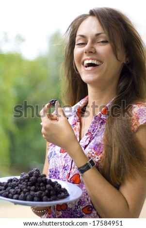 laughing beautiful woman with blackberry - stock photo