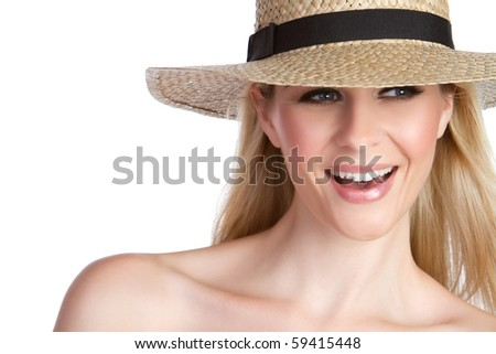 Laughing blond woman wearing hat - stock photo